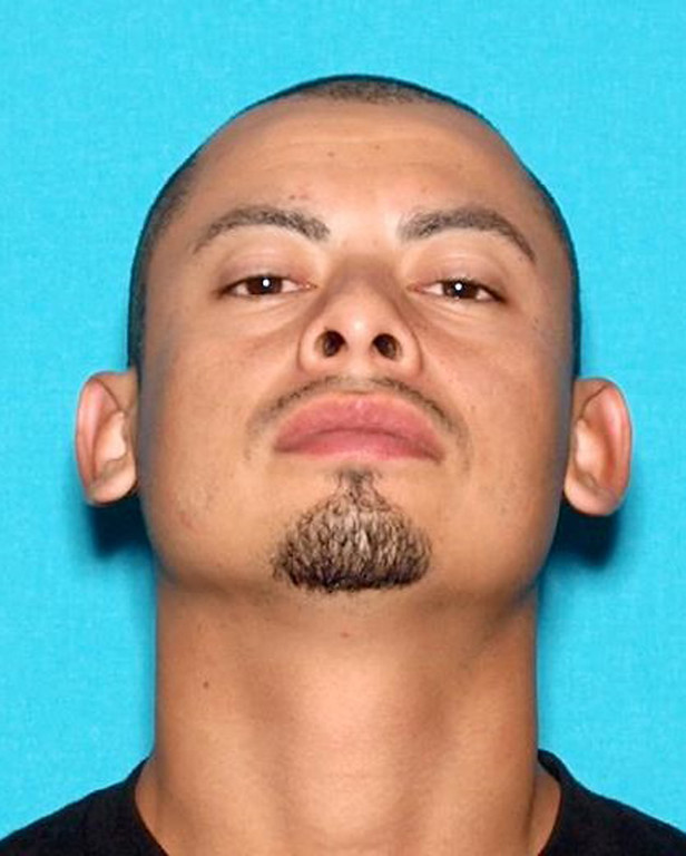 . This undated photo shows Jesse Perez, one of at least three people remaining at large after hundreds of federal and local law enforcement officers fanned out across Los Angeles in pre-dawn sweeps, serving arrest and search warrants as part of a three-year investigation into the ultra-violent street gang MS-13, Wednesday, May 17, 2017. Twenty-one people named in the indictment were arrested and warrants were served at more than 50 locations. The FBI said Perez should be considered armed and dangerous. (FBI via AP)