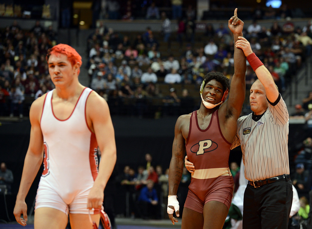 . DENVER, CO. - FEBRUARY 23: Corry Williams of Ponderosa High School won 5A 182 pound class State Championship against Joel Hernandez of Brighton High School at Pepsi Center February 23, 2013. Denver, Colorado. (Photo By Hyoung Chang/The Denver Post)