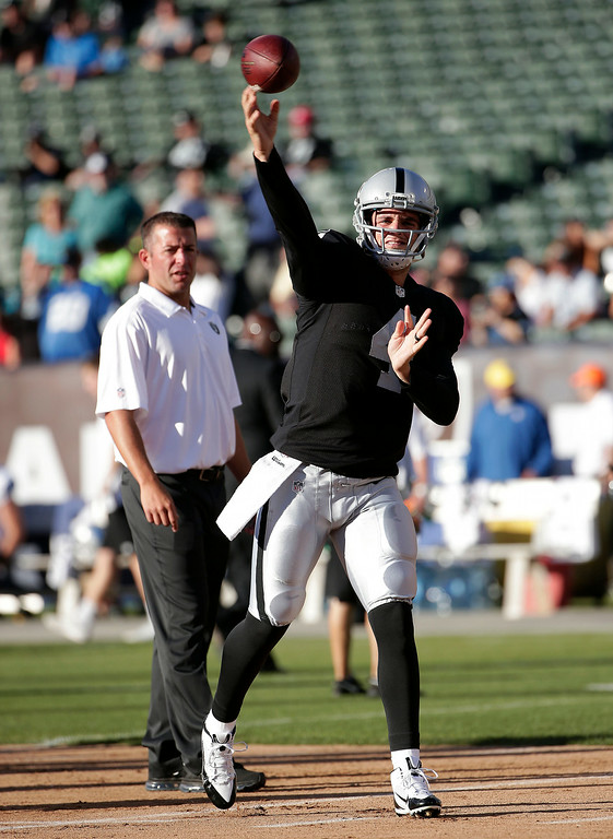 . Oakland Raiders quarterback Derek Carr (4) warms up before an NFL preseason football game against the Detroit Lions in Oakland, Calif., Friday, Aug. 15, 2014. (AP Photo/Marcio Jose Sanchez)