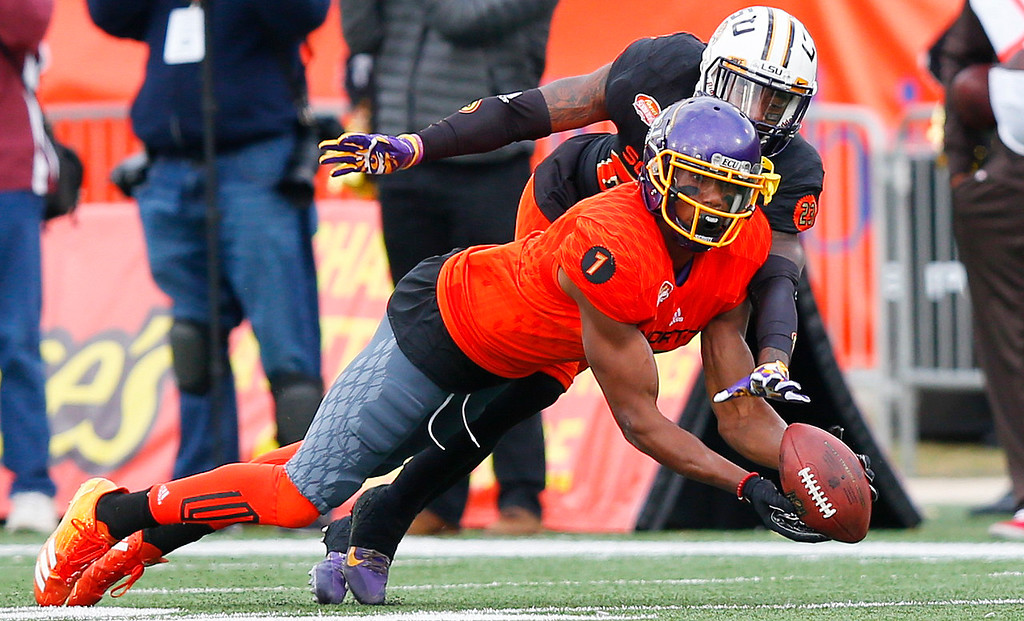 . North wide receiver Zay Jones (7) of East Carolina catches a pass against South safety Johnathan Ford of Auburn during the second half of the Senior Bowl college football game, Saturday, Jan. 28, 2017, at Ladd�Peebles Stadium, in Mobile, Ala. The South won 16-15. (AP Photo/Brynn Anderson)