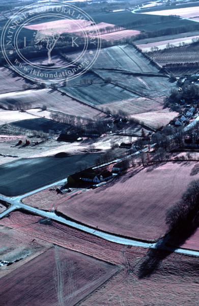 Farmland west Ravlunda, with ponds and prehistoric remains. Experimentally photographed with infrared film and Kodak Wratten gelatin filter No: 12 & 25 (2 April, 1989). | LH.0341