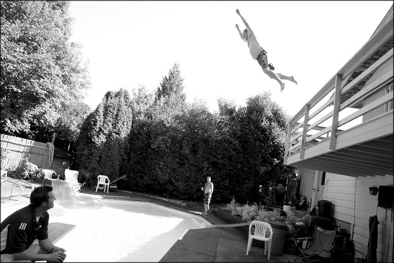One of the groomsmen jumps from a second-story balcony into the pool an hour before Sarah and Mark's wedding. (c) 2008 Matt Hagen