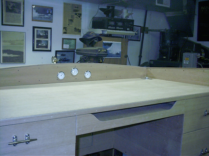 Finished desk top with instruments installed and gas filler used for cord grommet.