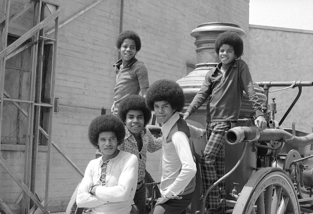 . The five Jackson brothers who sing as the Jackson Five, above, are about ready to resume school after a summer �vacation� on August 31, 1971, that took them to 40 cities in 60 days, playing concerts that attracted as many as 160,000. At top are Marlon, 14; left, and Michael, 12. Below are, left to right: Jackie 20; Tito 17, and Jermaine, 16. (AP Photo/David Smith)