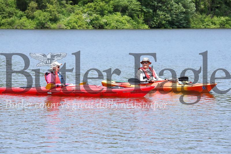 Slippery Rock senior center member Lynne Davis(left) paddles with Morraine State Park volunteer safety boater Bud Glenndenning. Seb Foltz/Butler Eagle