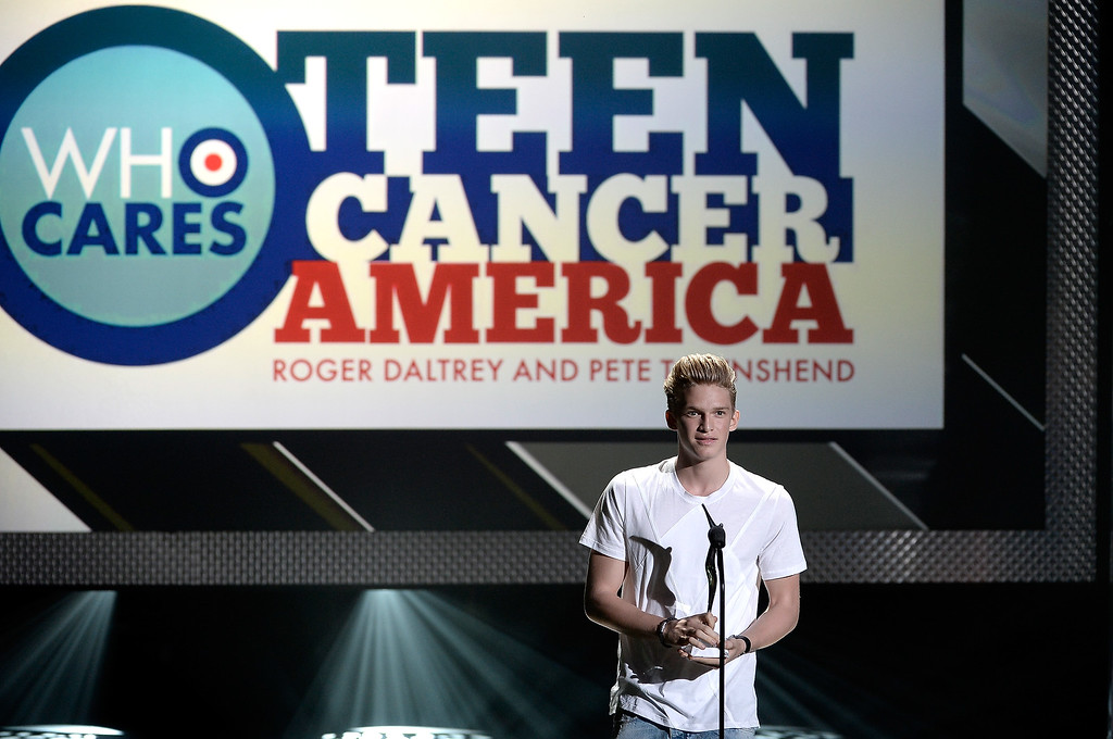 . Singer Cody Simpson receives the Teen Cancer America Role Model Award onstage during CW Network\'s 2013 Young Hollywood Awards presented by Crest 3D White and SodaStream held at The Broad Stage on August 1, 2013 in Santa Monica, California.  (Photo by Kevin Winter/Getty Images for PMC)
