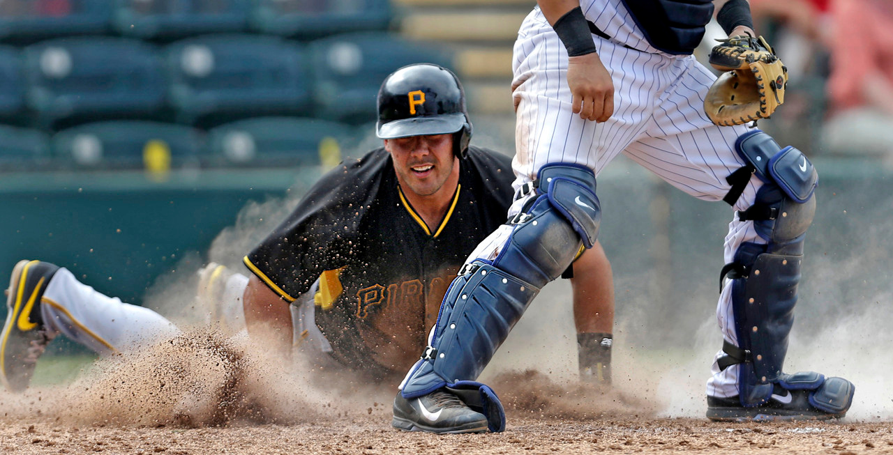 . Pirates base runnerTony Sanchez reaches home on an RBI single by teammate Chase d\'Arnaud as Twins catcher Josmil Pinto covers in the eighth inning of Pittsburgh\'s 8-4 win over Minnesota in Fort Myers, Fla., on Wednesday, March 12, 2014. (AP Photo/Gerald Herbert)