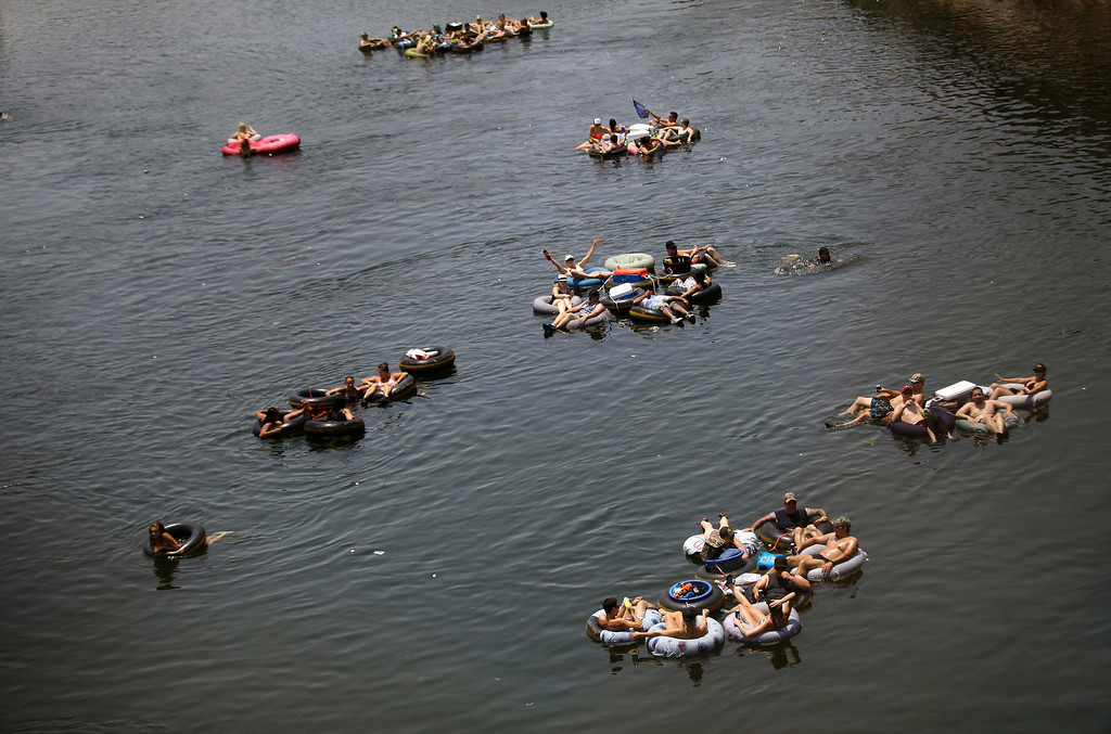 . People take advantage of a hot day by tubing on the Salt River near Mesa, Ariz., June 30, 2013. Much of the West has been in the mirth of an unrelenting heat wave. (Joshua Lott/The New York Times)