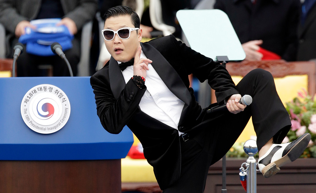 . South Korean rapper PSY performs before President Park Geun-hye\'s presidential inauguration ceremony at the National Assembly in Seoul, South Korea, Monday, Feb. 25, 2013. Park became South Korea\'s first female president Monday, returning to the presidential mansion where she grew up with her dictator father.  (AP Photo/Lee Jin-man)