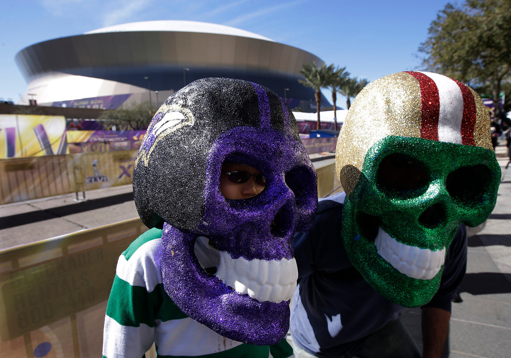 . David and Evan Waksman, from New York, pose with skull helmets outside the Superdome before the NFL Super Bowl XLVII football game between the San Francisco 49ers and the Baltimore Ravens Sunday, Feb. 3, 2013, in New Orleans. (AP Photo/Mark Humphrey)
