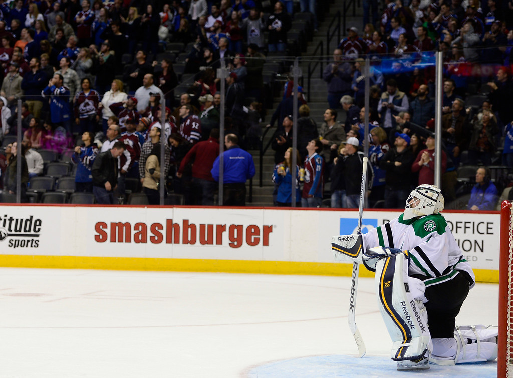 . Dallas Stars goalie Jhonas Enroth (1) takes a knee after missing his fourth block of the night during the third period Saturday, February 14, 2015 at the Pepsi Center in Denver, Colorado. (Photo By Brent Lewis/The Denver Post)