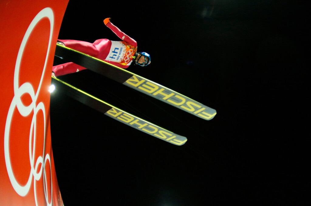 . In this photo taken with a fisheye lens Poland\'s Maciej Kot makes his trial jump during the ski jumping large hill qualification at the 2014 Winter Olympics, Friday, Feb. 14, 2014, in Krasnaya Polyana, Russia. (AP Photo/Dmitry Lovetsky)