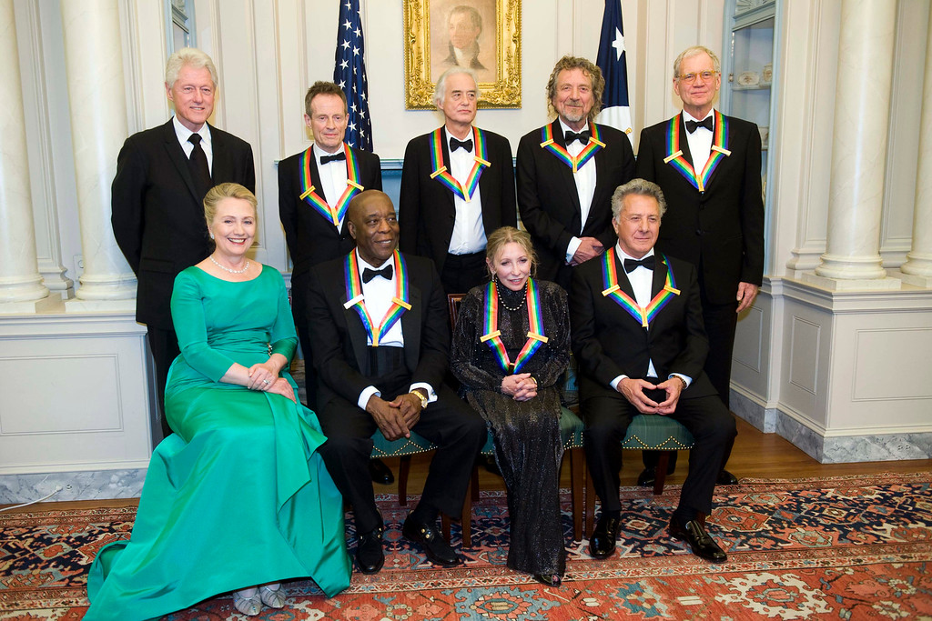 . From left, former President Bill Clinton, Secretary of State Hillary Rodham Clinton join the 2012 Kennedy Center Honorees John Paul Jones, Buddy Guy, Jimmy Page, Natalia Makarova, Robert Plant, Dustin Hoffman, and David Letterman for a group photo after the State Department Dinner for the Kennedy Center Honors gala Saturday, Dec. 1, 2012 at the State Department in Washington. (AP Photo/Kevin Wolf)