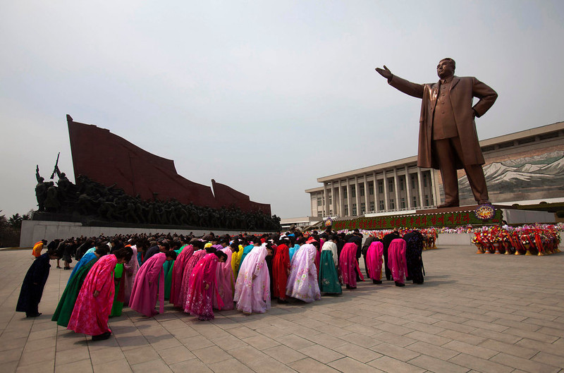 ". North Koreans pay their respects before a monument of Kim Il Sung at Mansu Hill in Pyongyang, North Korea on Thursday April 14, 2011. April 15 is called ""The Day of the Sun\"" in honor of the former guerrilla fighter who founded North Korea in 1948. People began to celebrate on the eve of the 99th anniversary of Kim Il Sung\'s birthday.  (AP Photo/David Guttenfelder)"