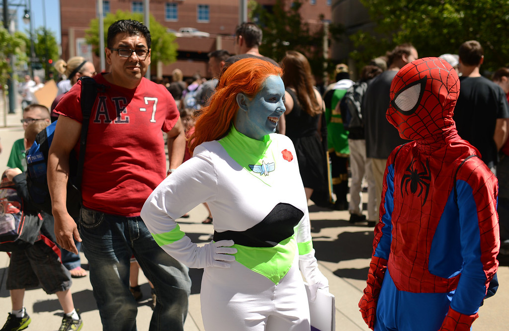 . DENVER, CO. - MAY 31: Stephanie Casdorph, 21, with Buzz Lightyear costume and her brother Hayden, 14, with Spider-Man costume are in the line for the opening day of Denver Comic Con at Colorado Convention Center. Denver, Colorado. May 31, 2013. (Photo By Hyoung Chang/The Denver Post)