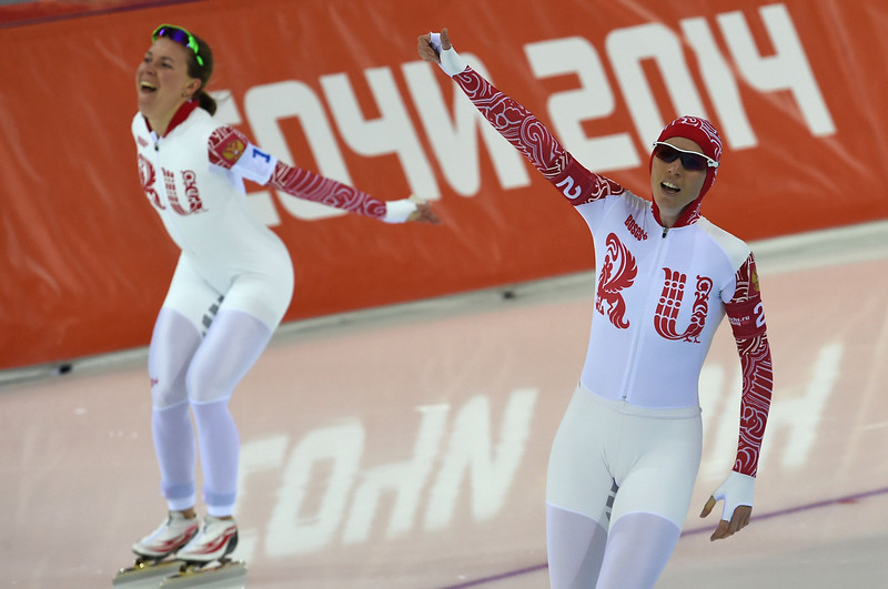 . (From L) Russia\'s Olga Graf and Russia\'s Ekaterina Lobysheva celebrate after the Women\'s Speed Skating Team Pursuit Final at the Adler Arena during the Sochi Winter Olympics on February 22, 2014.  (DAMIEN MEYER/AFP/Getty Images)
