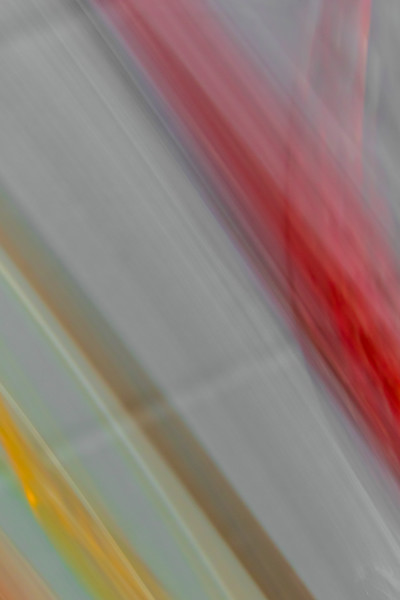 Slanted grays, reds and orange in a vertical image