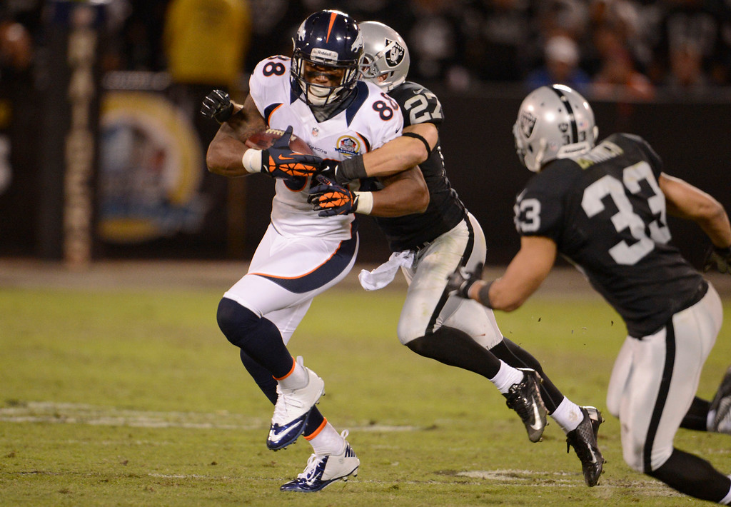 . Denver Broncos wide receiver Demaryius Thomas (88) picks up a few yards as he is brought down by Oakland Raiders free safety Matt Giordano (27) during the third quarter Thursday, December 6, 2012 during Thursday Night Football at O.c Coliseum in Oakland  John Leyba, The Denver Post