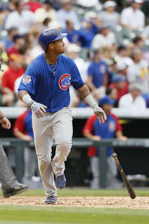 . Chicago Cubs shortstop Starlin Castro #13 watches his home run against the Chicago Cubs at Coors Field on August 7, 2014 in Denver, Colorado.  The Chicago Cubs defeated the Colorado Rockies 6-2.  (Photo by Trevor Brown, Jr./Getty Images)