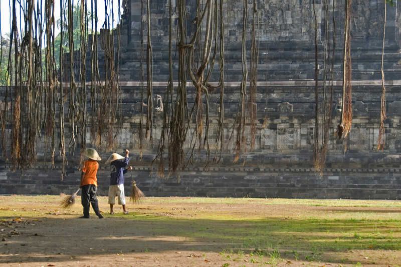 Workers sweeping at the front of the Borobudur temple grounds in Java, Indonesia