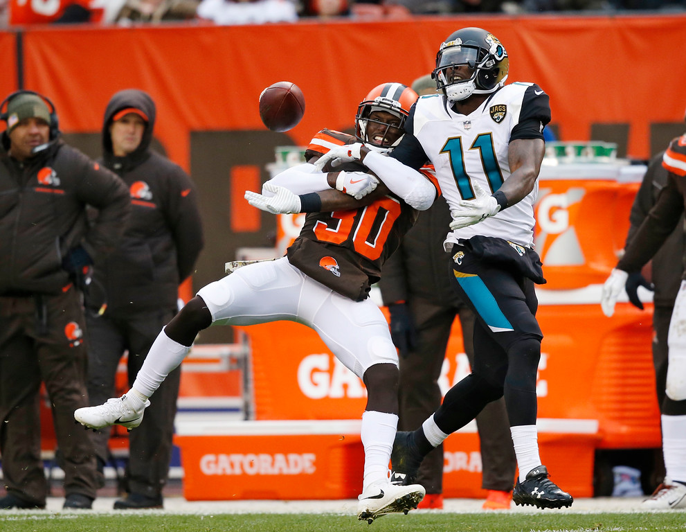 . Cleveland Browns defensive back Jason McCourty (30) breaks up a pass intended for Jacksonville Jaguars wide receiver Marqise Lee (11) in the second half of an NFL football game, Sunday, Nov. 19, 2017, in Cleveland. (AP Photo/Ron Schwane)