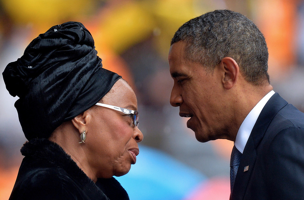. US President Barack Obama (R) talks with the widow of South African President Nelson Mandela, Graca Machel, during the memorial service for late South African President Nelson Mandela at Soccer City Stadium in Johannesburg on December 10, 2013. Mandela, the revered icon of the anti-apartheid struggle in South Africa and one of the towering political figures of the 20th century, died in Johannesburg on December 5 at age 95. Mandela, who was elected South Africa\'s first black president after spending nearly three decades in prison, had been receiving treatment for a lung infection at his Johannesburg home since September, after three months in hospital in a critical state. ALEXANDER JOE/AFP/Getty Images