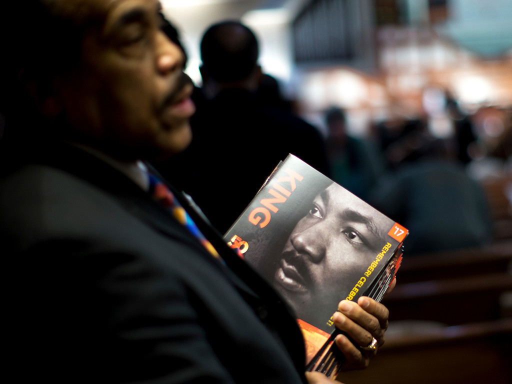 . James R. Johnson hands out programs before the Rev. Martin Luther King Jr. holiday commemorative service at Ebenezer Baptist Church, Monday, Jan. 16, 2017, in Atlanta. (AP Photo/Branden Camp)