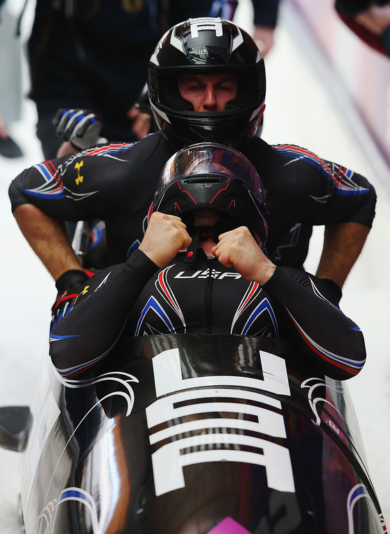 . Pilot Steven Holcomb, Curtis Tomasevicz, Steven Langton and Christopher Fogt of the United States team 1 finish a run during the Men\'s Four-Man Bobsleigh on Day 16 of the Sochi 2014 Winter Olympics at Sliding Center Sanki on February 23, 2014 in Sochi, Russia.  (Photo by Alex Livesey/Getty Images)