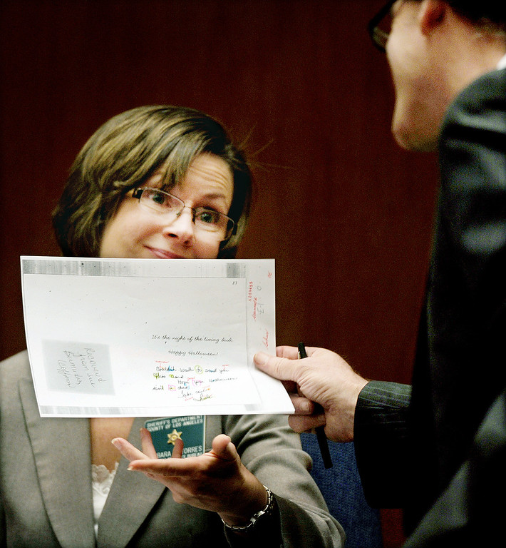 . Barbara Tores, Los Angeles County Sheriff\'s Forensic Documentation Examiner gave the defence lawyer her own copy of Linda Sohus handwriting on a Halloween card.  The prosecutor and defence have rested in the murder trial of Christian Karl Gerhartsreiter, at Clara Shortridge Foltz Criminal Justice Center in Los Angeles Wednesday,  April 3, 2013. He has pleaded not guilty to the killing of John Sohus, 27, who disappeared with his wife, Linda, in 1985 while Gerhartsreiter was a guest cottage tenant at the home of Sohus\' mother, where the couple lived. (Photo by Walt Mancini/SGVN)