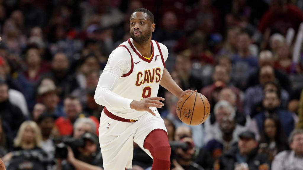 . Cleveland Cavaliers\' Dwyane Wade goes to the Miami Heat. (AP Photo/Tony Dejak)