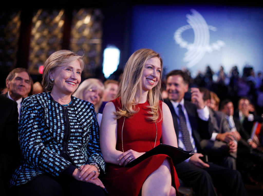. Former Secretary of State Hillary Rodham Clinton, left, and her daughter Chelsea Clinton, center, listen to President Barack Obama and former President Bill Clinton speak at the  Clinton Global Initiative in New York, Tuesday, Sept. 24, 2013. (AP Photo/Pablo Martinez Monsivais)