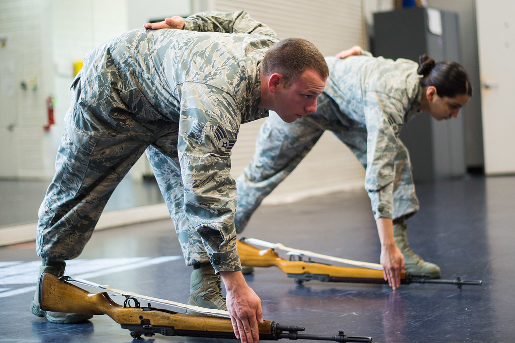 . Senior Airman Joseph Trujillo, left, and Staff Sgt. Anahi Ledezma practice color rifle movement at March Air Reserve Base in Riverside, Calif. on Wednesday, May 13, 2015. (Photo by Watchara Phomicinda/ Los Angeles Daily News)