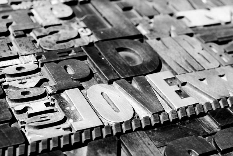 Amour Flea Market — Paris, France — May 2009  A collection of old printing press letters at a Paris flea market.