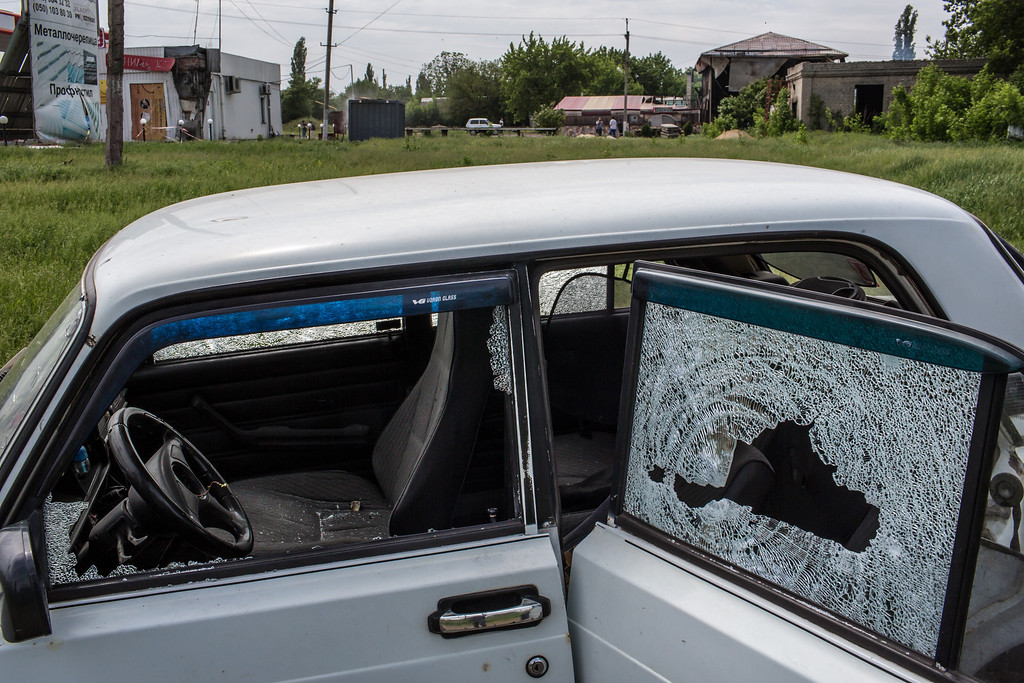 . A car is riddled with bullet holes at the scene of an early morning firefight between the pro-Ukraine Donbass Battalion and the pro-Russia Vostok Battalion militias on May 23, 2014 in Karlivka, Ukraine. (Photo by Brendan Hoffman/Getty Images)