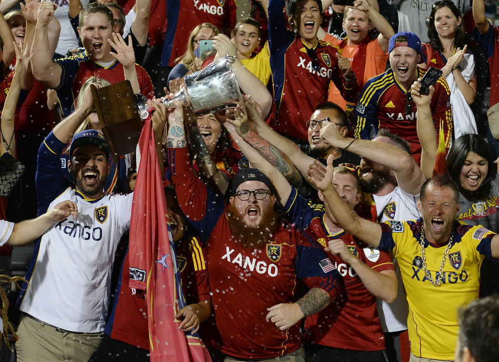 . COMMERCE CITY, CO - AUGUST 1: Salt Lake fans celebrated the win with the Rocky Mountain Cup after the game. Real Salt Lake defeated the Colorado Rapids 1-0 at Dick\'s Sporting Goods Park Saturday night, August 1, 2014.  Photo by Karl Gehring/The Denver Post