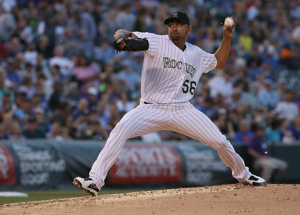 . DENVER, CO - AUGUST 05:  Relief pitcher Franklin Morales #56 of the Colorado Rockies delivers against the Chicago Cubs at Coors Field on August 5, 2014 in Denver, Colorado.  (Photo by Doug Pensinger/Getty Images)