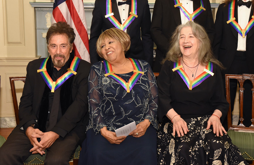 . Kennedy Center Honorees, from left, Al Pacino, Mavis Staples and Martha Argerich wait for the group portrait following the State Department for the Kennedy Center Honors gala dinner, Saturday, Dec. 3, 2016, in Washington. (AP Photo/Kevin Wolf)