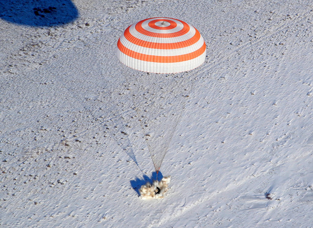. The Russian Soyuz MS-05 space capsule lands about 150 km (90 miles) south-east of the Kazakh town of Zhezkazgan, Kazakhstan, Thursday, Dec. 14, 2017. Three astronauts on Thursday landed back on Earth after nearly six months aboard the International Space Station. (AP Photo/Dmitri Lovetsky, Pool)