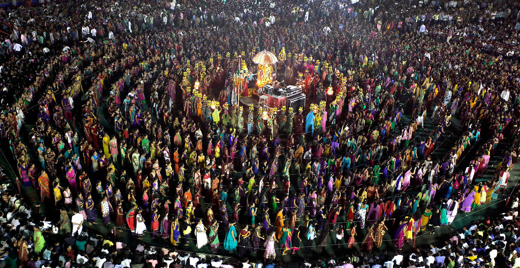 . ndian devotees dance around Hindu deity Umiya Mata temple on the eighth night of Navratri in Surat in the western Indian state of Gujarat. Every year thousands of devotees participate in this ritual, where they pray to nine different forms of Hindu Goddess Durga. (AP Photo/Ajit Solanki)