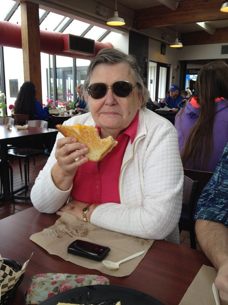Mike;s Mom enjoying her grilled cheese.