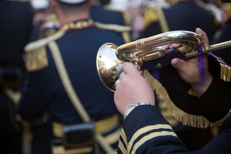 A musician handling the key of a cornet, Seville, Spain