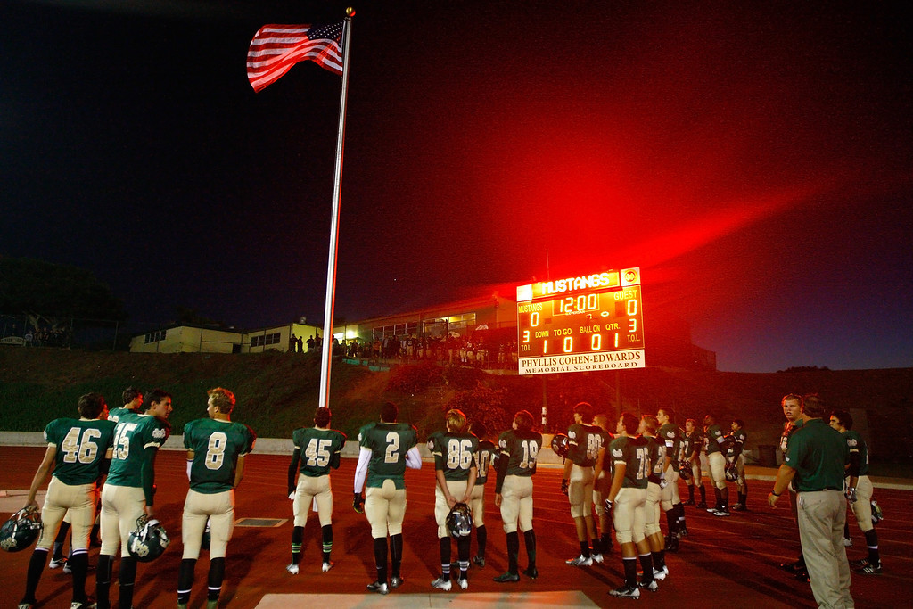 . Mira Costa players during the national anthem before kickoff against Palos Verdes in a Bay League matchup at Mira Costa High School on Friday, October 18, 2013 in Manhattan Beach, Calif.  (Michael Yanow / For the Daily Breeze)