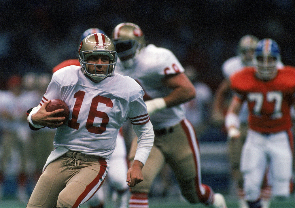 . Quarterback Joe Montana #16 of the San Francisco 49ers runs with the ball in Super Bowl XXIV against the Denver Broncos at Louisiana Superdome on January 28, 1990 in New Orleans, Louisiana.     (Photo by George Rose/Getty Images)