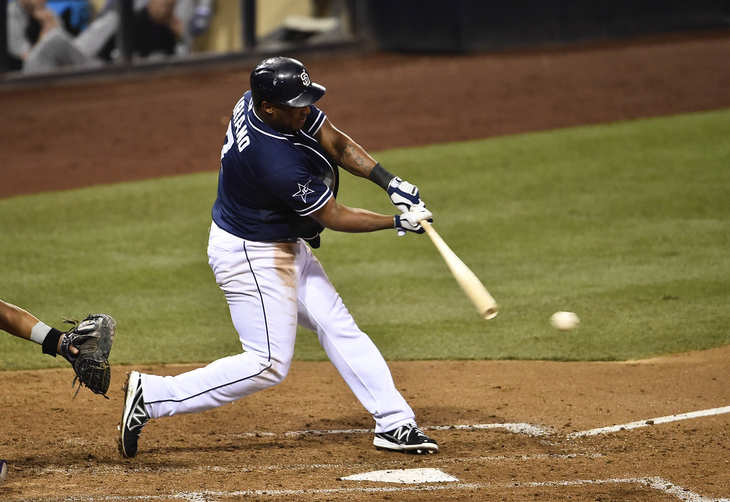 . SAN DIEGO, CA - SEPTEMBER 23:  Rymer Liriano #7 of the San Diego Padres hits an RBI single during the sixth inning of a baseball game against the Colorado Rockies at Petco Park September, 23, 2014 in San Diego, California.  (Photo by Denis Poroy/Getty Images)