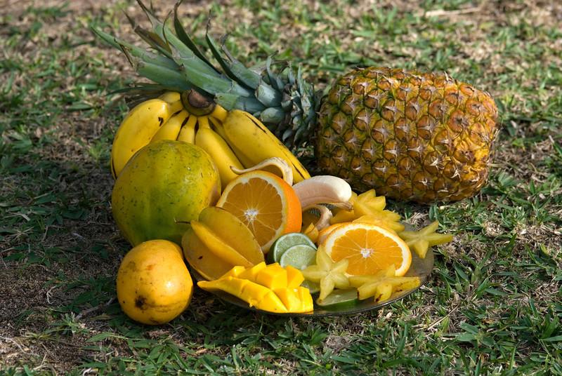 Fruits Star fruit, oranges, lime, pineapple, bananas