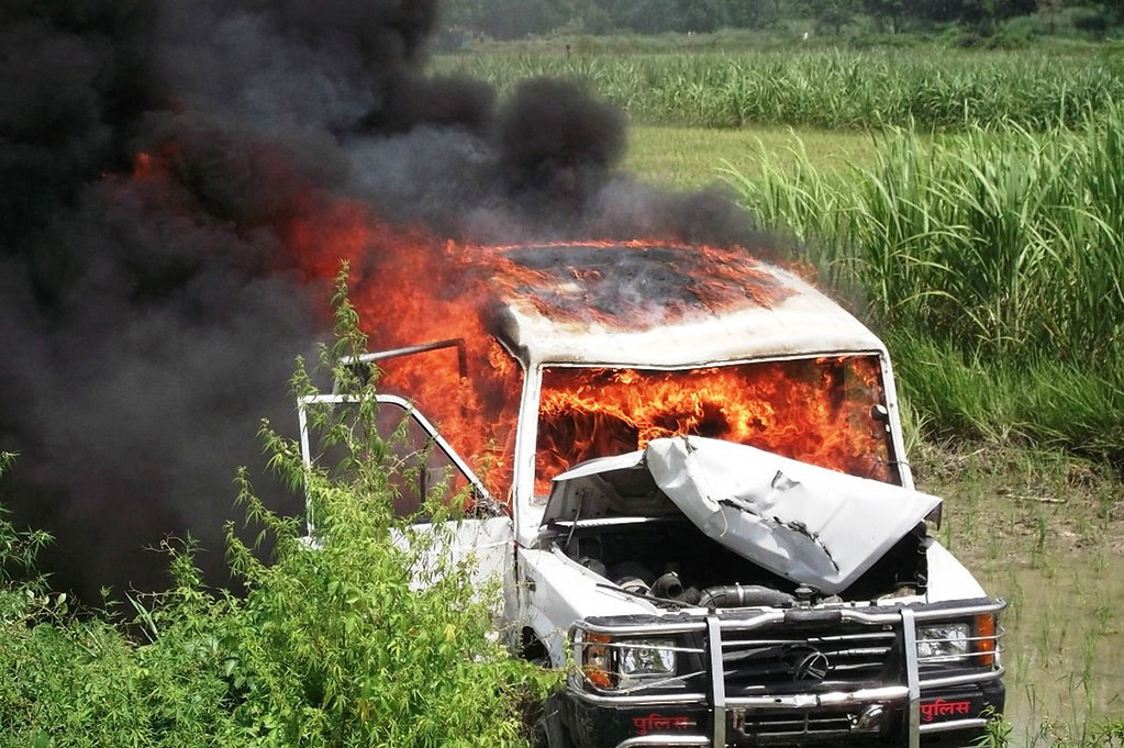 . A vehicle set alight by demonstrators protesting the deaths of schoolchildren who consumed a free mid day meal at a school in the Saran district of Bihar state, burns in Chhapra on July 17, 2013.  Twenty-two children have died after eating a free lunch feared to contain poisonous chemicals at an Indian primary school, officials said, as the tragedy sparked angry street protests.  AFP PHOTOSTR/AFP/Getty Images