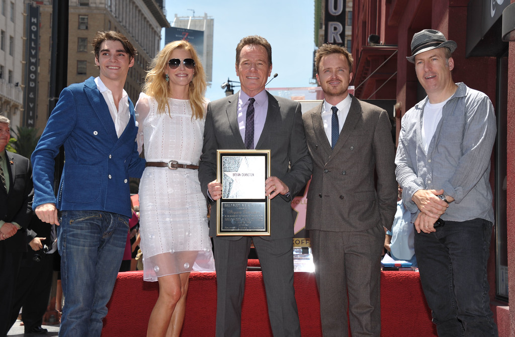 """. Bryan Cranston, center, star of the television series \""""Breaking Bad,\"""" poses with fellow cast members, left to right, RJ Mitte, Anna Gunn, Aaron Paul and Bob Odenkirk after Cranston received a star on the Hollywood Walk of Fame on Tuesday, July 16, 2013 in Los Angeles. (Photo by John Shearer/Invision for AMC/AP Images)"""