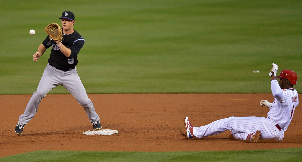 . DJ LeMahieu #9 of the Colorado Rockies catches the ball at second base to force out Domonic Brown #9 of the Philadelphia Phillies in the second inning at Citizens Bank Park on May 28, 2014 in Philadelphia, Pennsylvania.  (Photo by Drew Hallowell/Getty Images)