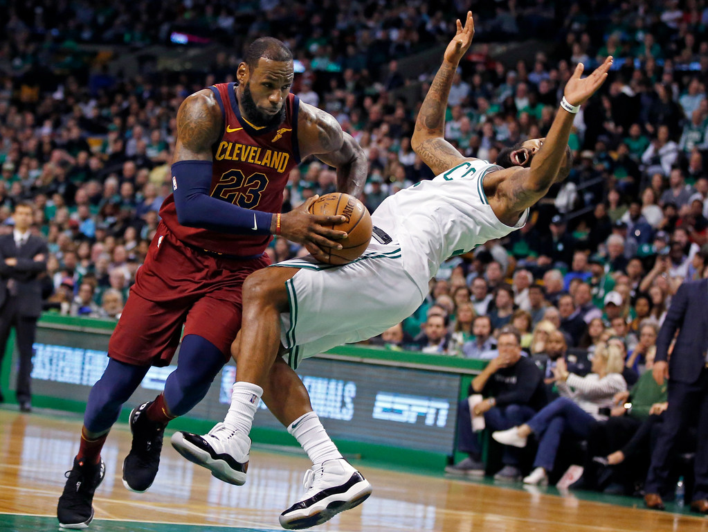 . Cleveland Cavaliers forward LeBron James drives against the defense of Boston Celtics forward Marcus Morris, right, during the first quarter of Game 1 of the NBA basketball Eastern Conference Finals, Sunday, May 13, 2018, in Boston. (AP Photo/Michael Dwyer)