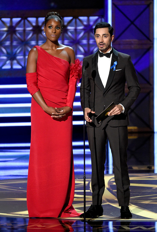 . Issa Rae, left, and Riz Ahmed present the award for outstanding supporting actress in a limited series or movie at the 69th Primetime Emmy Awards on Sunday, Sept. 17, 2017, at the Microsoft Theater in Los Angeles. (Photo by Chris Pizzello/Invision/AP)
